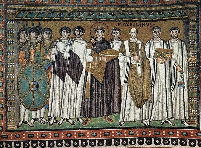 Figure 3 Emperor Justinian's soldier carrying Chi-Rho-marked shield in a mosaic at San Vitale, Ravenna, 6th c. Source.