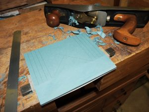 Cotton blue jean board being profiled to fit the manuscript.