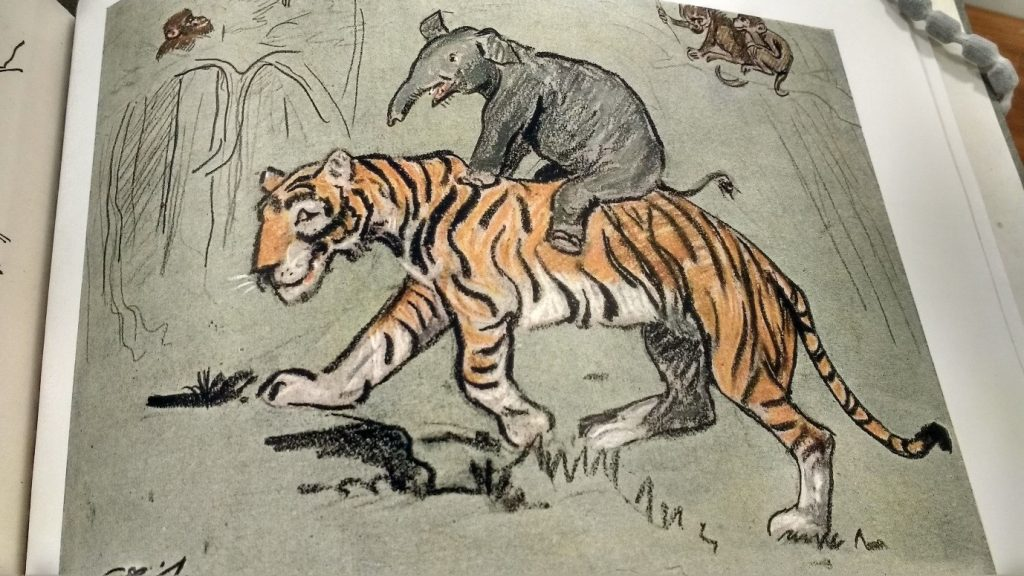 ele riding tiger
